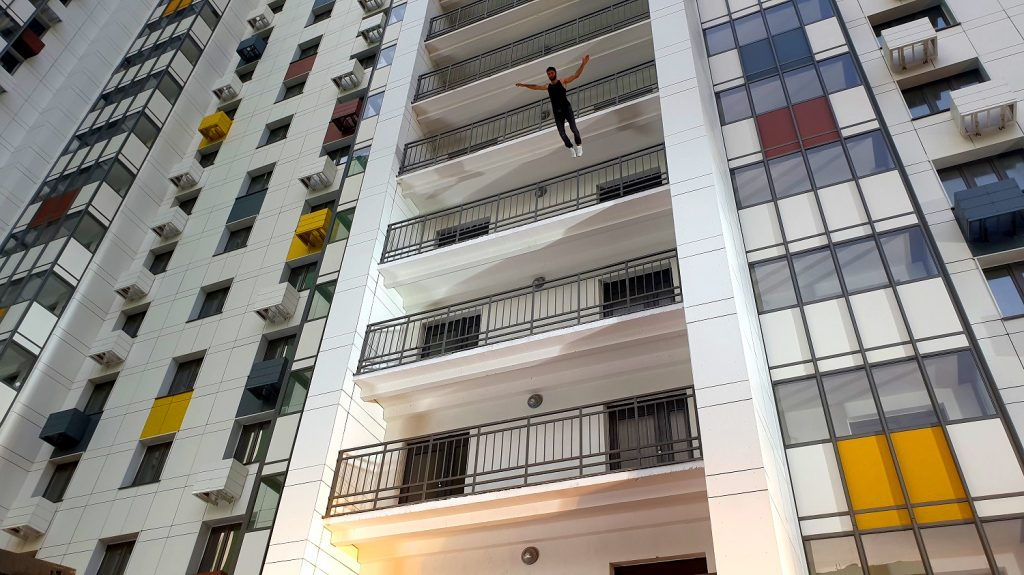 A stuntman jumps from a balcony