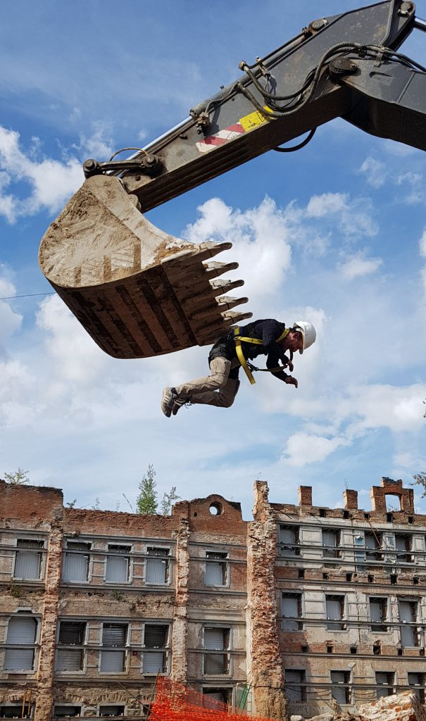 On the excavator hangs Oleg Surnov